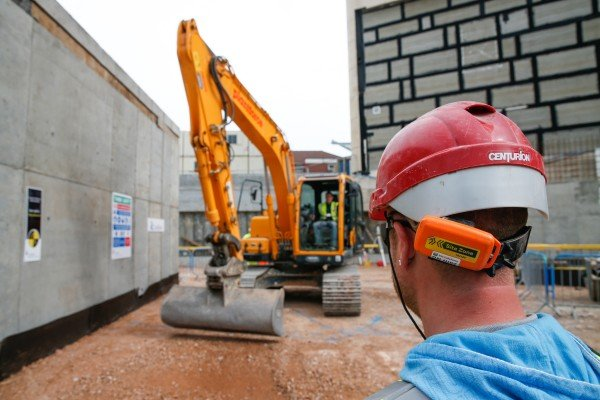 Construction workers demonstrate the On Guard proximity devices at the Southmead Hospital site in Bristol, England on April 10 2015. Photo by Jim Ross