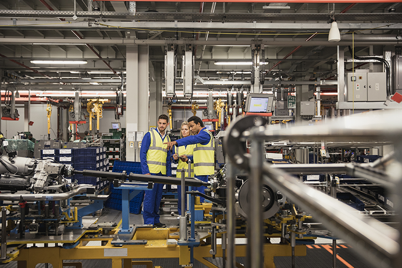 Behavioural safety management: Factory Workers Discussing on the Production Line