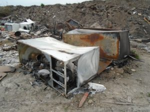 Farmer gets suspended prison sentence after admitting illegally burning fridges and animals