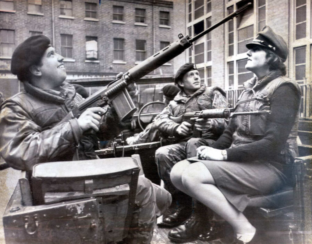 British Army Northern Ireland Soldiers on Patrol taking part in a search duty in Belfast Military soldier uniform beret weapons